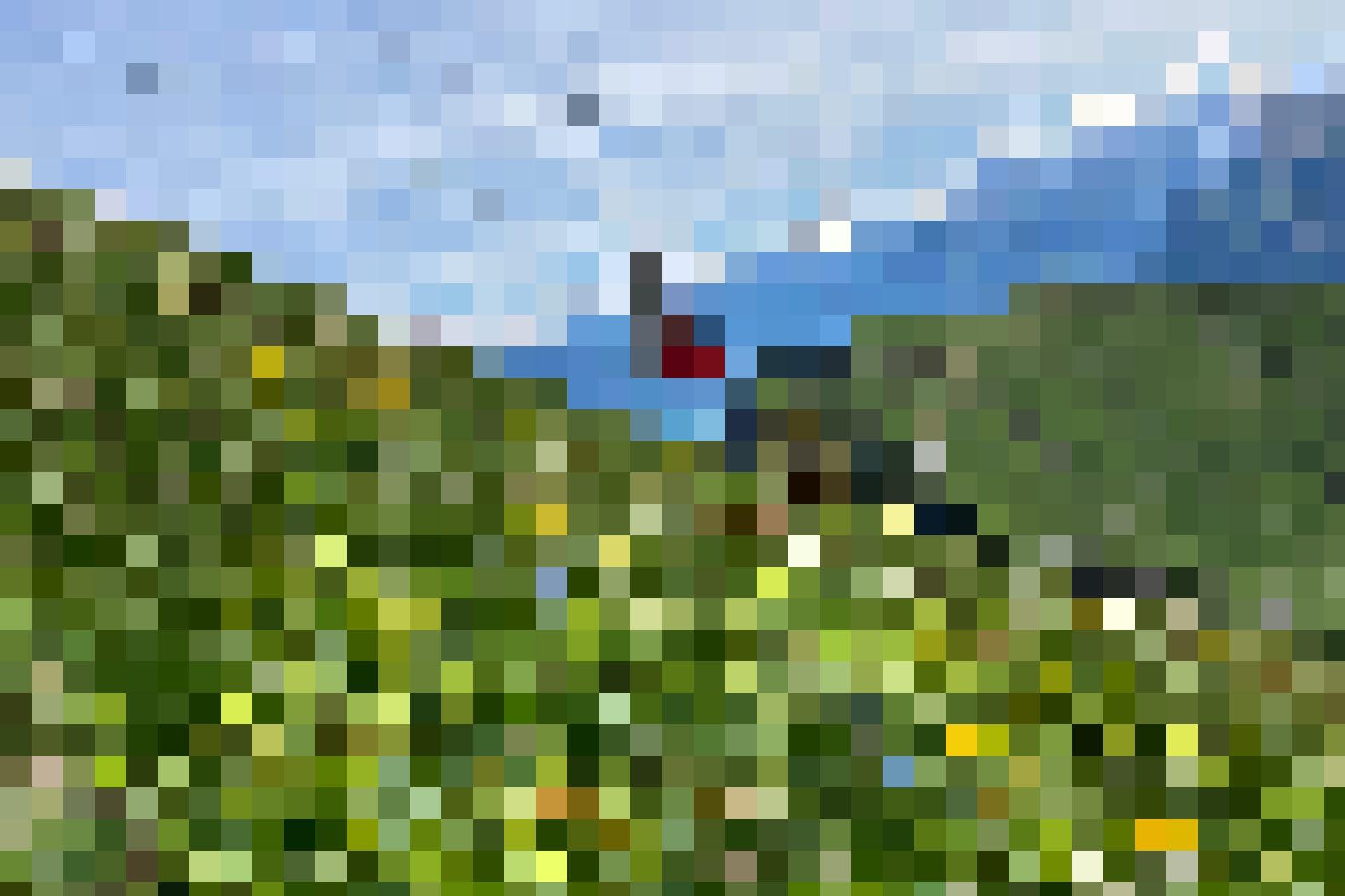Die Stockhornbahn und im Hintergrund der Thunersee